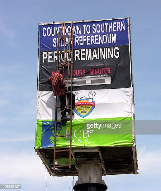 A workman repairs an electronic sign counting down to southern Sudan's referendum on independence in Juba Sudan November 2 2010 Voters in the...