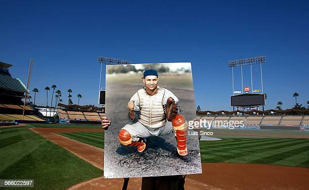 A workman sets up a protrait of late Brooklyn Dodgers great Roy Campanella at home plate in Dodger Stadium on Thursday Sept 23 2010 The Dodgers held...