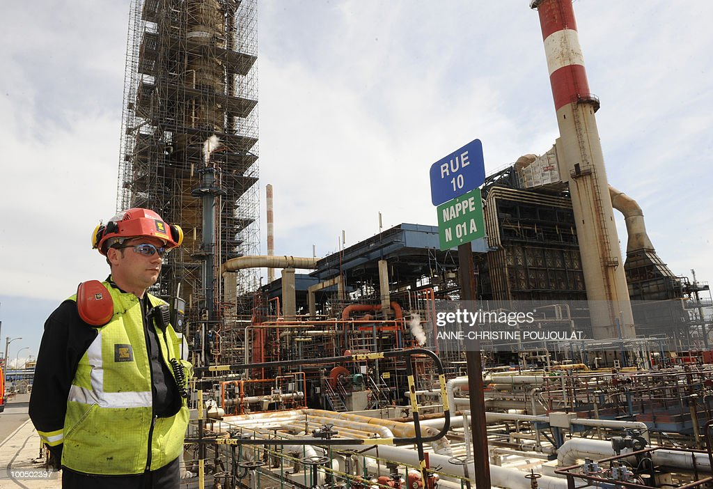 A workman stands at the site of the mediterranean refinery of Lavera which belongs to British group Ineos, taken on April 26, 2010 in Martigues, southern France.