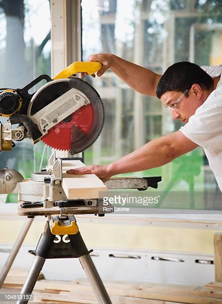 Workman using a circular saw