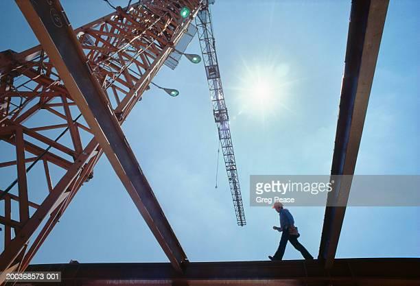 Workman walking on steel beam (Digital Enhancement)