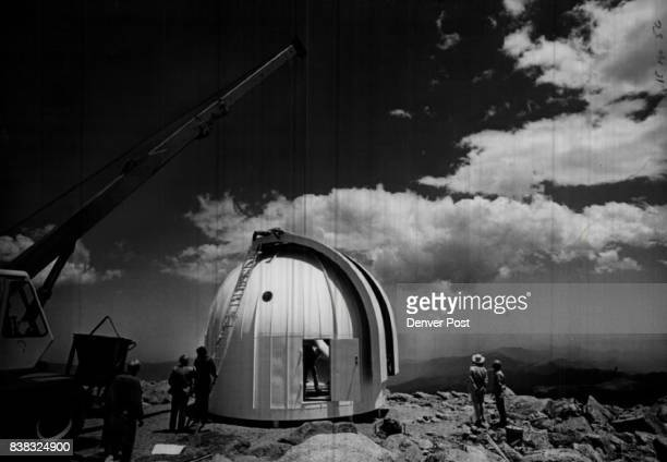 Workmen and scientists unload and assemble the University of Denver's 24inch EalingBeck reflecting telescope near the summit of Mt Evans Credit...