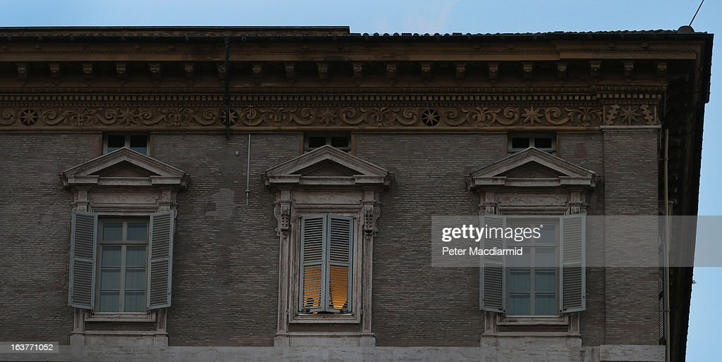 Workmen are seen in the central window of the Papal apartments on March 15, 2013 in Vatican City, Vatican. Pope Francis is expected to move into the accommodation after renovation work is completed in the next few days.