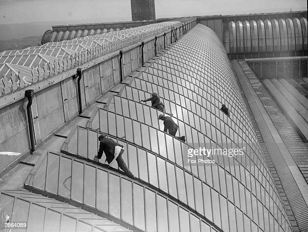 Workmen carrying out repairs on the glass roof of Crystal Palace