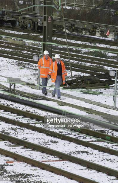 Workmen check the lines of the West coast route while work is carried out at Willesden junction Work to replace equipment that dates back to the...