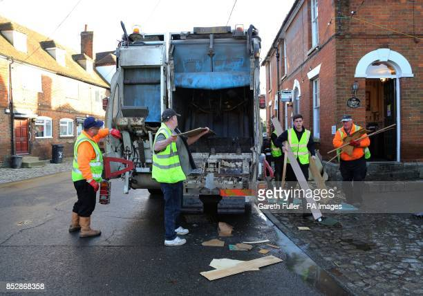 Workmen Clear Debris From Homes In Yalding Kent After It Was Flooded During The Recent Bad
