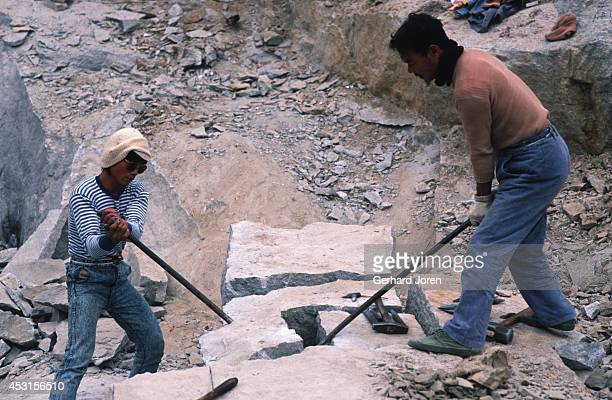Workmen cut granite blocks in a quarry near Chong Wu town Hui'An county
