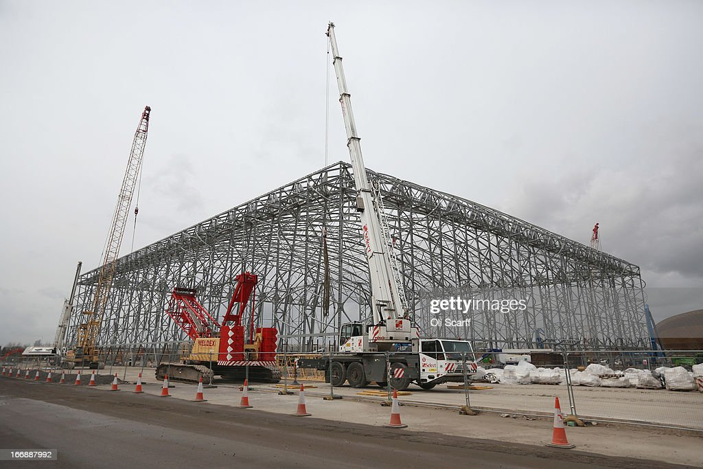 Workmen dismantle the basketball stadium which was used in the London 2012 Olympic Games prior to the opening of a portion of the park to the general public on April 16, 2013 in London, England. In 100 days the first section of the developed site of the 2012 Olympic Games, which will be known as Queen Elizabeth Olympic Park, will welcome visitors. The park's 292 million GBP conversion includes the removal of temporary venues, the refitting of stadia for public use, the removal of Olympic Games sponsor's retail units and extensive landscaping. The re-opening of the northern portion of the park will take place on July 27, 2013, on first anniversary of the London 2012 Olympics, for a festival celebrating the culture of East London. The park will be fully open to the public in spring 2014.