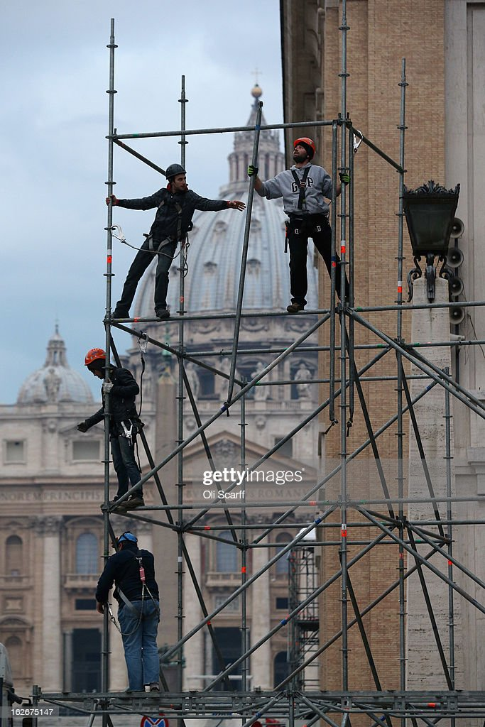 Workmen erect scaffolding in front of the Basilica ahead of Pope Benedict XVI's last public audience on February 26, 2013 in Rome, Italy. The Pontiff will hold his last weekly public audience on February 27, 2013 before he retires the following day. Pope Benedict XVI has been the leader of the Catholic Church for eight years and is the first Pope to retire since 1415. He cites ailing health as his reason for retirement and will spend the rest of his life in solitude away from public engagements.