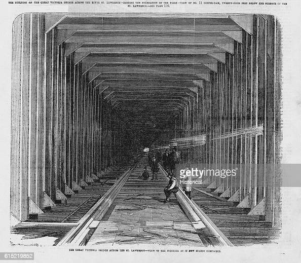 Workmen in the nearly completed Victoria Bridge The covered railroad bridge connected the island of Montreal to the South Shore of mainland Quebec...