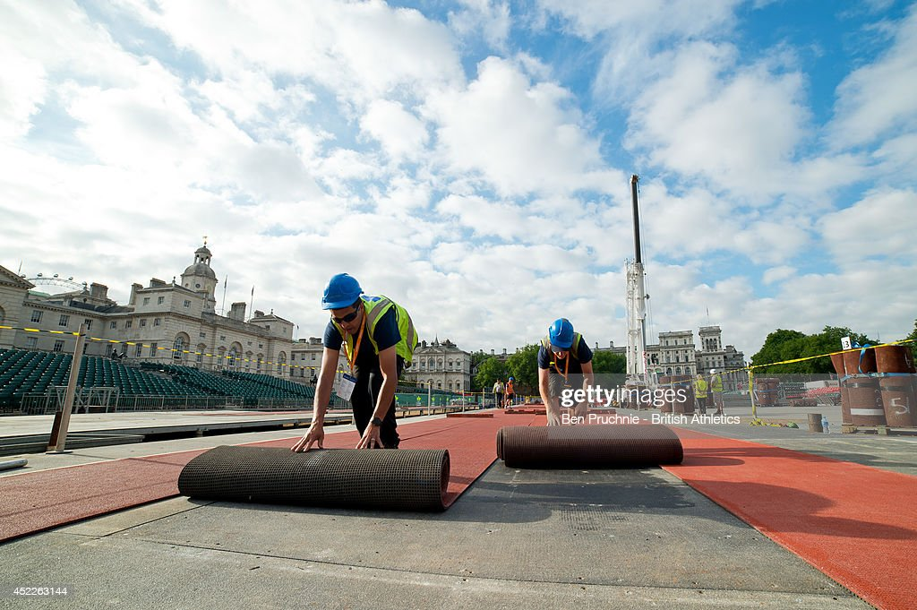 Workmen lay the track for the Sainsbury's Anniversary Games at Horse Guards Parade on July 17, 2014 in London, England. Sections of the track from the London 2012 Olympic Stadium are being reused in the temporary stadium in the iconic setting of Horse Guards Parade that will host The Sainsbury's Anniversary Games on Sunday 20th July.