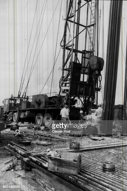 Workmen manhandle a blowout preventer Site is between Galveston and Houston On pipe in front of them are casing head ram casing hangar and secondary...