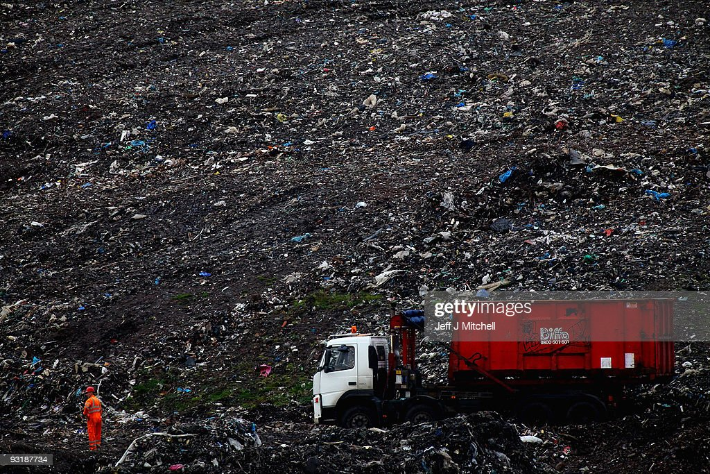Workmen move waste at a landfill site on November 18, 2009 in the east end of Glasgow, Scotland. As world leaders prepare to gather for the Copenhagen Climate Summit in December, the resolve of the industrial nations seems to be weakening with President Obama stating that it would be impossible to reach a binding deal at the summit. Climate campaigners are concerned that this disappointing announcement is a backward step ahead of the summit.