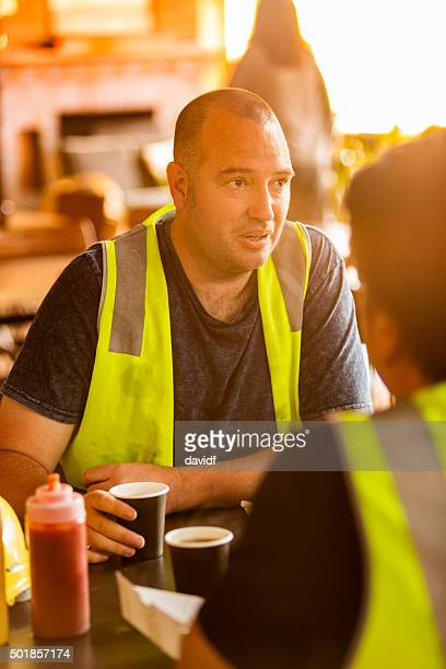 Workmen On A Coffee Break in High Visibility Clothes