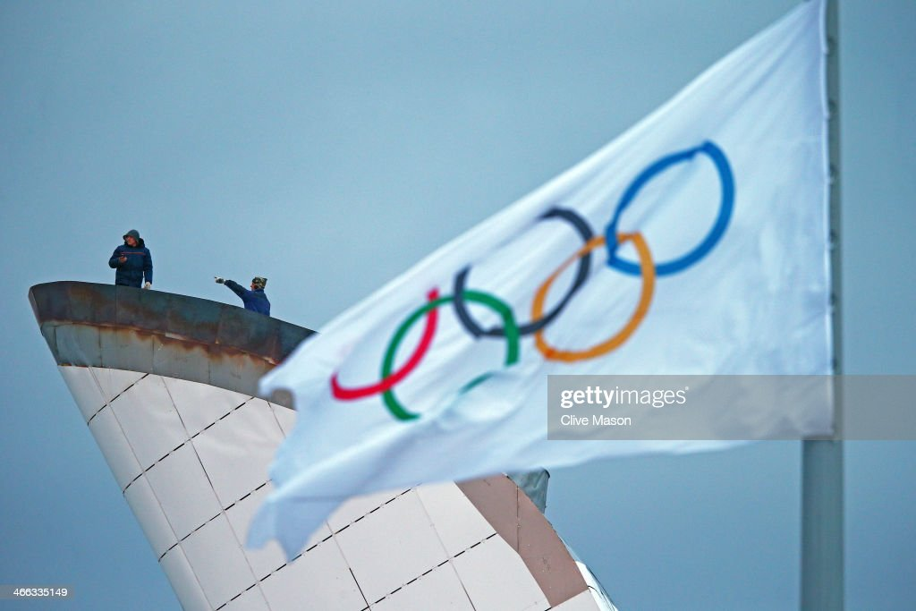 Workmen prepare the Olympic flame cauldron prior to the Sochi 2014 Winter Olympics at the Adler Arena Skating Center on February 1, 2014 in Sochi, Russia.