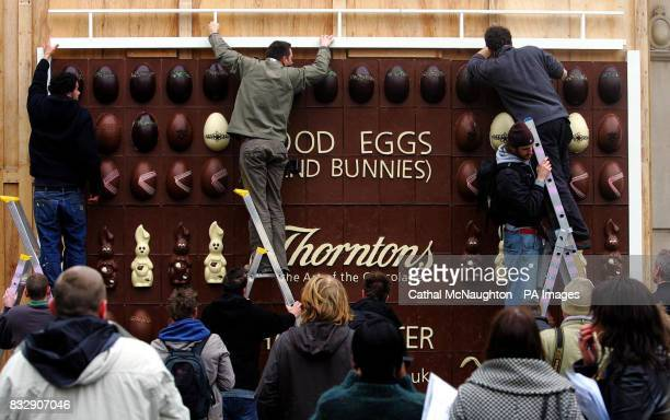 Workmen put the finishing touches to the worlds first edible chocolate billboard at Covent Garden central London