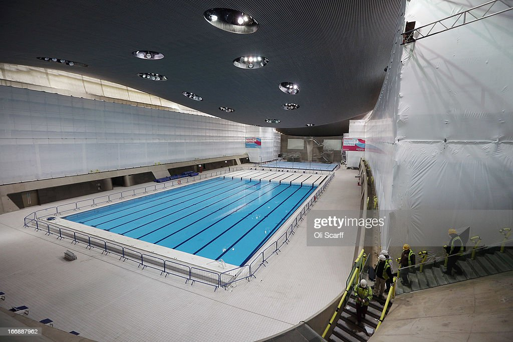 Workmen redevelop the Aquatics Centre which was used in the London 2012 Olympic Games prior to the opening of a portion of the park to the general public on April 16, 2013 in London, England. In 100 days the first section of the developed site of the 2012 Olympic Games, which will be known as Queen Elizabeth Olympic Park, will welcome visitors. The park's 292 million GBP conversion includes the removal of temporary venues, the refitting of stadia for public use, the removal of Olympic Games sponsor's retail units and extensive landscaping. The re-opening of the northern portion of the park will take place on July 27, 2013, on first anniversary of the London 2012 Olympics, for a festival celebrating the culture of East London. The park will be fully open to the public in spring 2014.