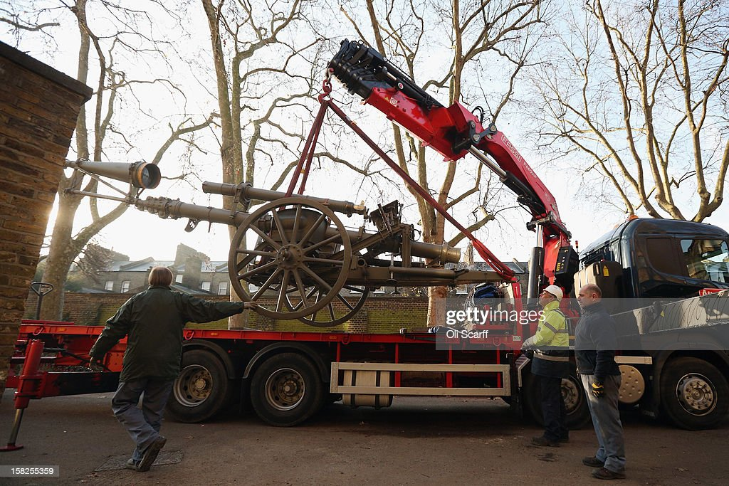 Workmen remove a First World War German Mast Periscope from the Imperial War Museum on December 12, 2012 in London, England. It will be conserved whilst IWM London is closed from January 2, 2013 until July 1, 2013 for a major refurbishment.
