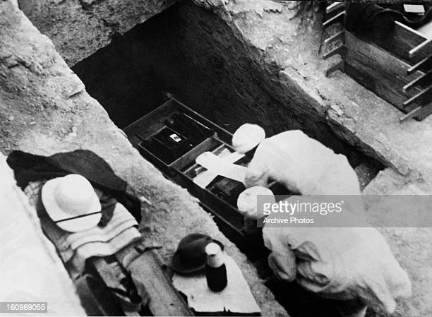 Workmen removing a wooden shrine from the tomb of Tutankhamun in the Valley of the Kings Egypt circa 1923