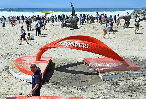 Workmen repair a sculpture on Tamarama Beach which was damaged by large waves at the Sculpture by the Sea exhibition in Sydney on October 25 2016...