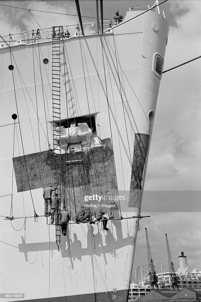 Workmen repairing the bow of a ship in London docks c1945c1965
