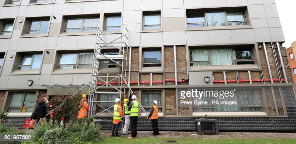 Workmen start to remove cladding on Hornchurch Court Hulme Manchester as as Prime Minister Theresa May has said there must be a quotmajor national...