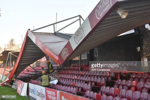Workmen survey the damage to the roof of Turners Cross stadium home to the Munster Football Association and League of Ireland side Cork City in...