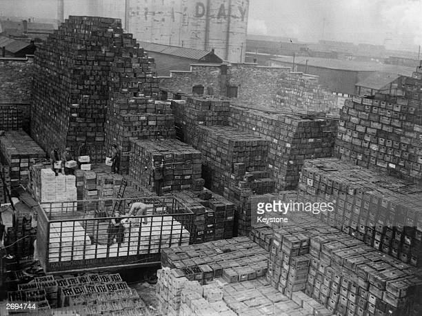 Workmen unloading crates of beer stacked at a New York brewery shortly after the repeal of prohibition The repeal of prohibition was a key policy of...