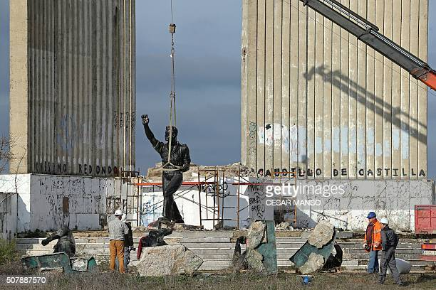 Workmen use a crane to dismantle the Onesimo Redondo monument in Valladolid on February 1 2016 in line with Article 15 of the historical memory law...