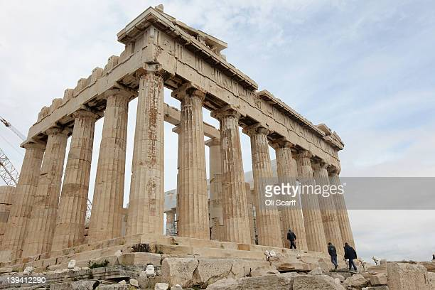 Workmen walk into the Parthenon on the Acropolis as restoration takes place on February 20 2012 in Athens Greece Following a meeting on Wednesday...