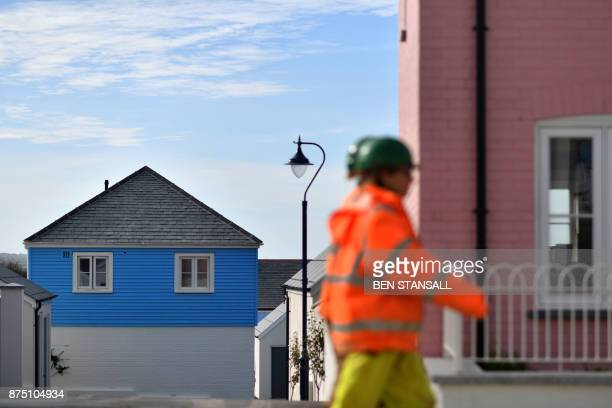 Workmen walk through Nansledan housing development championed by Britain's Prince Charles Prince of Wales at Newquay town in Cornwall on October 25...