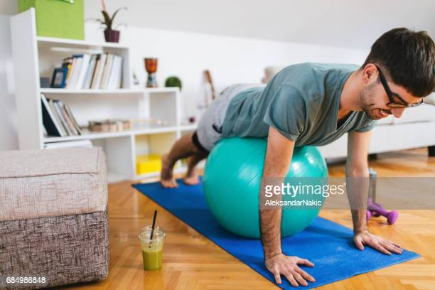 Workout at home with a fitness ball