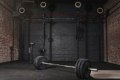 Workout gym with gym equipment. Barbell horizontal bars gymnastic rings.