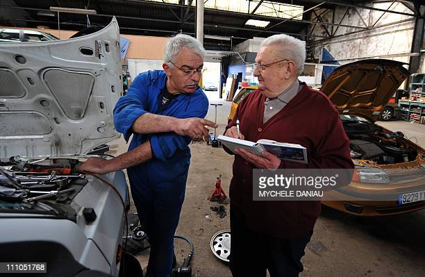 WORKPatrice a senior citizen works with Claude 77 years old at a garage in HérouvillesaintClair nothern France avril 24 2008 France where the...