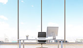 Table with computer for one, office. Panoramic window behind, blue sky and city view. Concept of work. 3D render