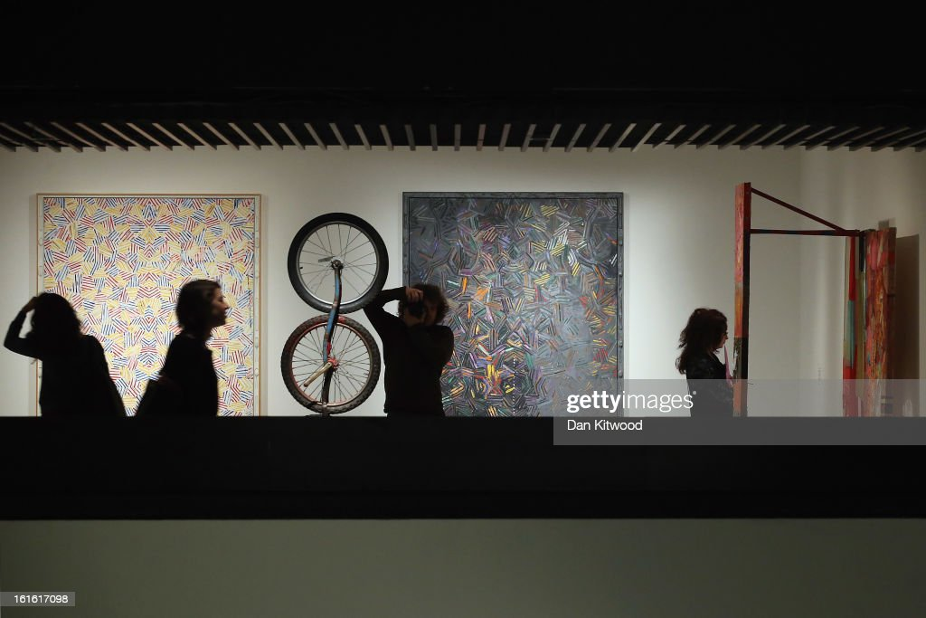 Works by Jasper Johns hang on the far wall as those by Robert Rauschenberg (2nd L and R) are also displayed during a press preview of 'The Bride and the Bachelors' exhibition at the Barbican Art Gallery on February 13, 2013 in London, England. The piece makes up a selection of works by artists and choreographers including Marcel Duchamp, Merce Cunningham, John Cage, Robert Rauschenberg and Jasper Johns, and runs at the Barbican Art Gallery until June 9, 2013.