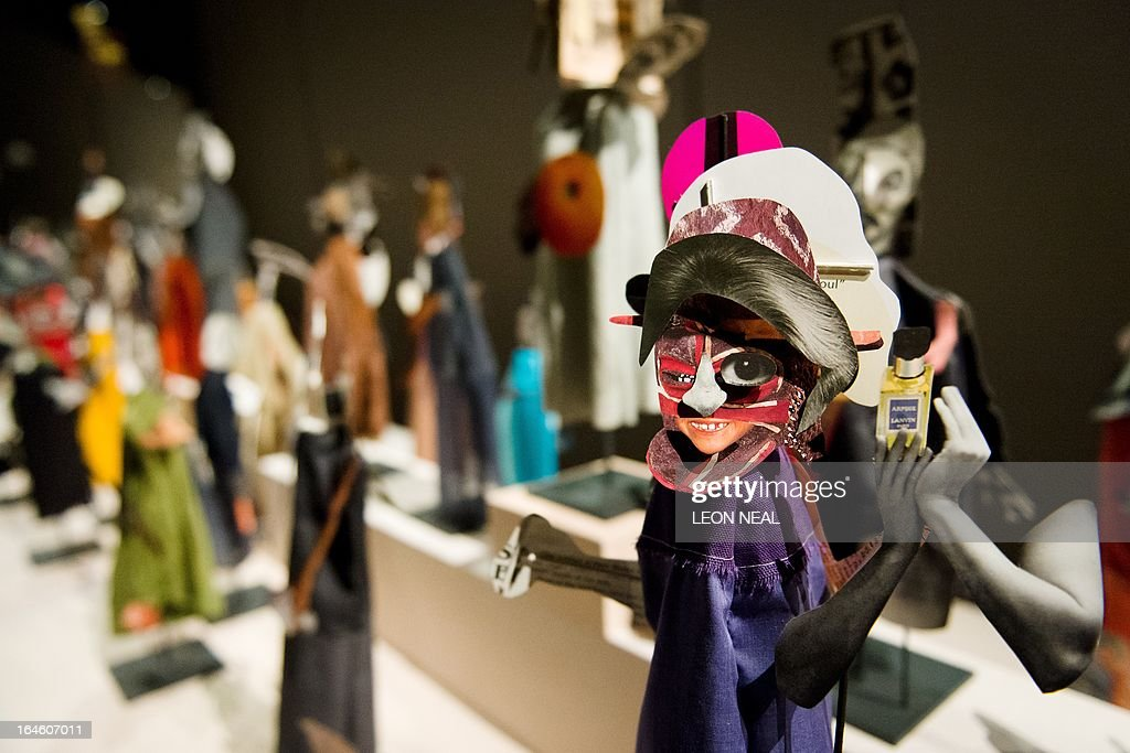 Works from 'The Surgeon and the Photographer' by Geoffrey Farmer are displayed in The Curve gallery of the Barican Centre in central London, on March 25, 2013. The 'puppet calendar' is made up of images cut from hundreds of second-hand books and is dislpayed over the 90-metre length of the gallery. 'The Surgeon and the Photographer' is free to view and open to the public from March 26 to July 28, 2013. AFP PHOTO/Leon Neal RESTRICTED