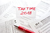 Workspace with various US forms. Tax time 2018