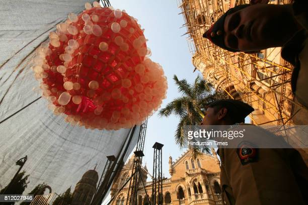 World Aids Day Policemen take a look at the 30foot tall giant installation of the HIV virus as seen under an electron microscope made of over 12000...