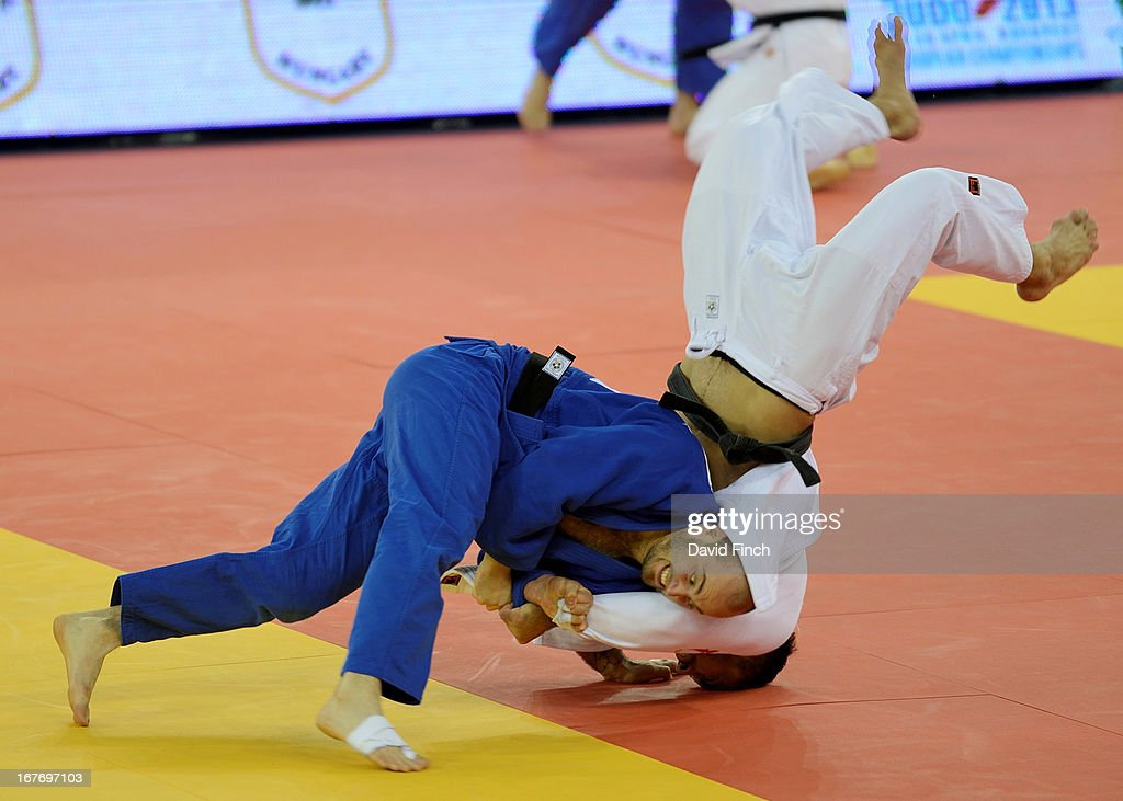 World and former Olympic champion, <a gi-track='captionPersonalityLinkClicked' href=/galleries/search?phrase=Ilias+Iliadis&family=editorial&specificpeople=2258296 ng-click='$event.stopPropagation()'>Ilias Iliadis</a> of Greece (white), is thrown for ippon (10 points) by Aleksander Marmeljuk of Estonia in their first u90kgs contest during the Budapest European Championships at the Papp Laszlo Sports Hall on April 27, 2013 in Budapest, Hungary.