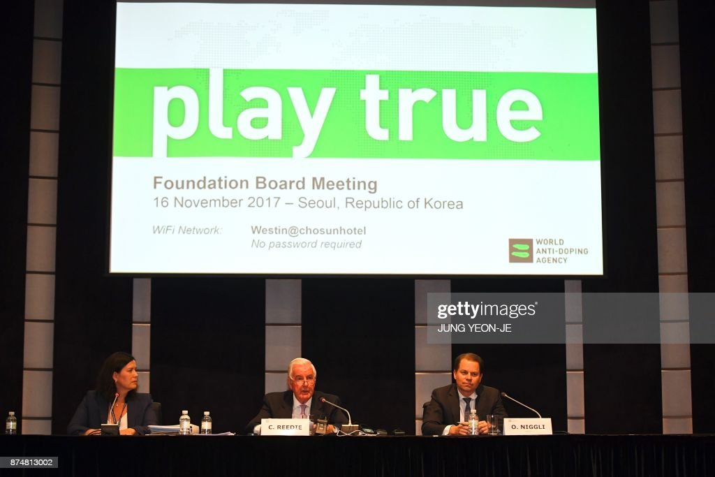 World Anti-Doping Agency (WADA) president Craig Reedie (C) speaks as WADA director general Olivier Niggli (R) looks on, during a press conference after the WADA's foundation board meeting in Seoul on November 16, 2017. The World Anti-Doping Agency maintained its suspension of Russia on November 16, raising the spectre of a possible ban from February's Winter Olympics in Pyeongchang. / AFP PHOTO / JUNG Yeon-Je