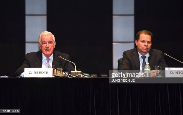 World AntiDoping Agency president Craig Reedie speaks as WADA director general Olivier Niggli looks on during a press conference after the WADA's...