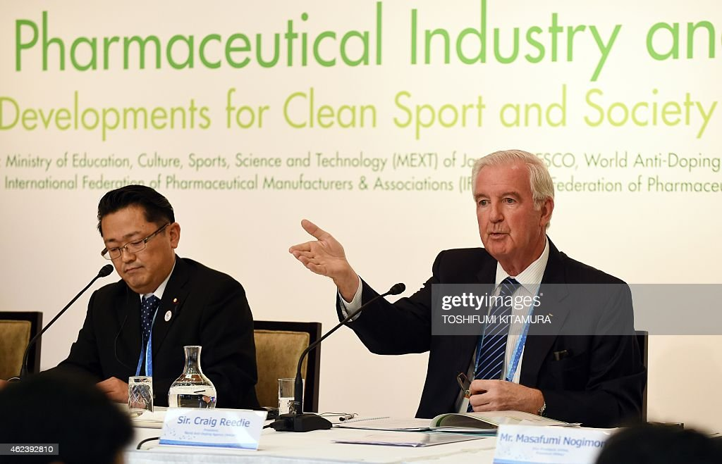 World Anti-Doping Agency president Craig Reedie (R) speaks beside Japanese deputy Education, Culture, Sports and Science Minister Hideki Niwa (L) during a press conference in the second International conference on the Pharmaceutical Industry and the Fight Against Doping in Tokyo on January 28 2015. AFP PHOTO / TOSHIFUMI KITAMURA