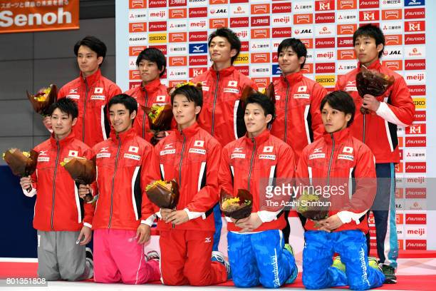 World Artistic Gymnastic Chamionships national team members Kohei Uchimura and Kenzo Shirai pose for photographs with national team candidates after...