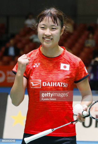 World badminton champion Nozomi Okuhara of Japan celebrates after beating her world championships final opponent Pusarla Sindhu of India 2118 218 in...