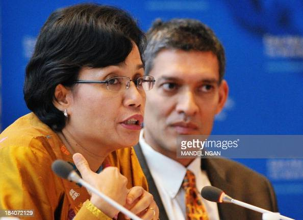 World Bank Chief Operating Officer and Managing Director Mulyani Indrawati speaks watched by Eswar Prasad of Cornell University during a discussion...