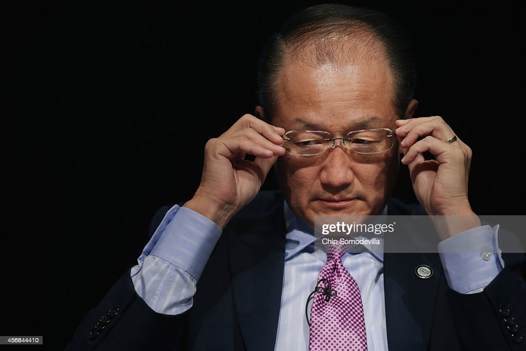 World Bank Group President Jim Yong Kim adjusts his glasses while participating in a discussion about the reduction of poverty in an unequal world...