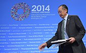 World Bank Group President Jim Yong Kim arrives for a press conference during the IMF World Bank 2014 Annual Meetings on October 9 2014 in Washington...