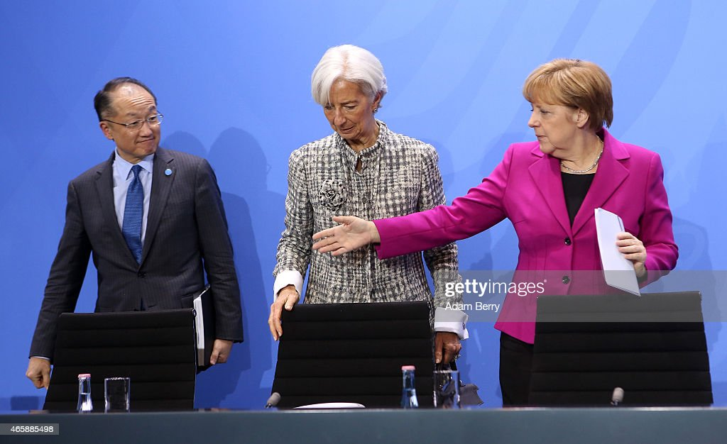 World Bank Group President Jim Yong Kim, International Monetary Fund Managing Director Christine Lagarde and German Chanceller Angela Merkel attend a press conference at the German federal Chancellery on March 11, 2015 in Berlin, Germany. Heads of the world's leading economic and financial organizations are meeting with the German chancellor to discuss several current issues including the crisis in Ukraine, the impending threat of financial meltdown in Greece and developments in the other eurozone economies, as Germany chairs the Group of Seven leading industrial nations this year.