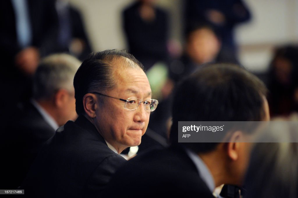 World Bank Group President Jim Yong Kim (C) listens during a press conference in Beijing on November 30, 2012. The World Bank is to launch a joint study with Beijing on urbanisation in China, one of the great human migrations of modern times, it said on November 30. AFP PHOTO / WANG ZHAO
